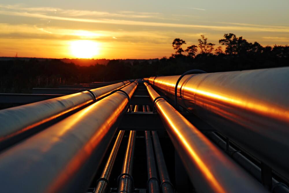 Oil pipeline against the sunset